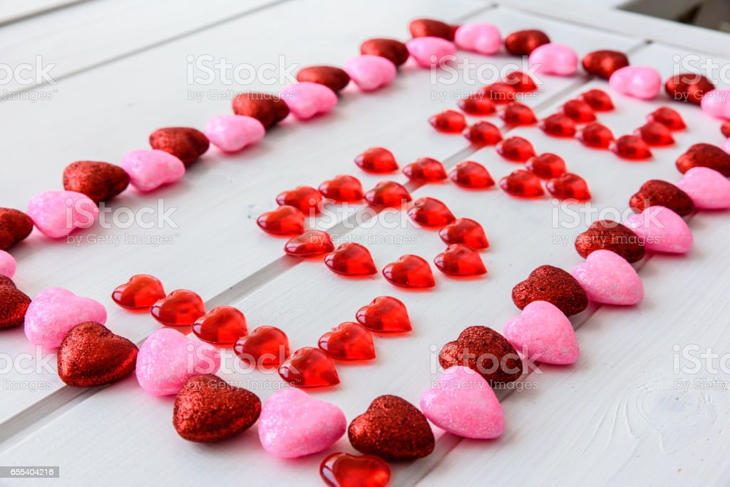 Valentines Day background with love text on grunge wooden desk stock photo