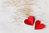 Valentines day card with hearts on a wooden background
