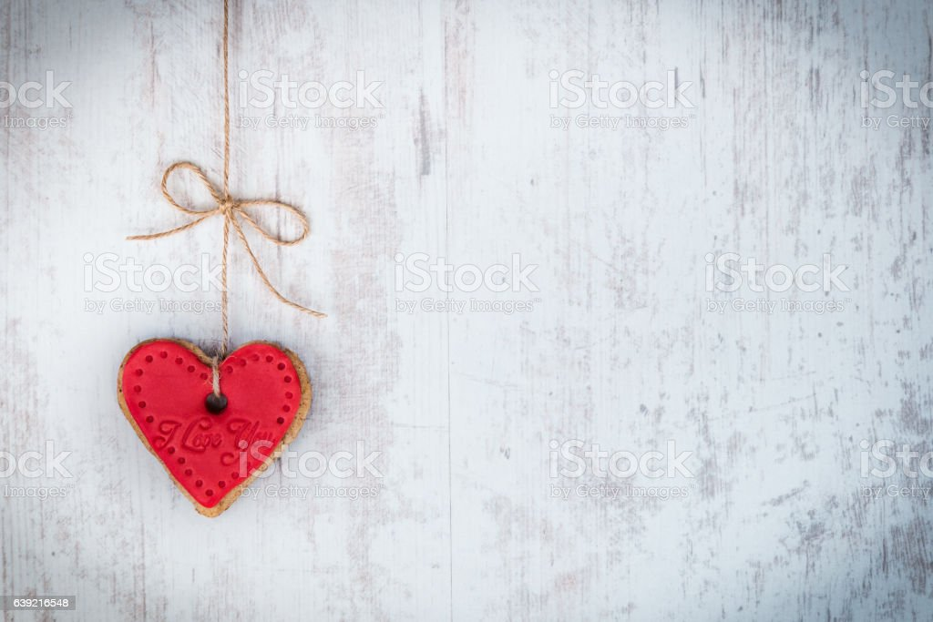 Valentines day concept. Heart shaped cookie tied with hemp bow. stock photo