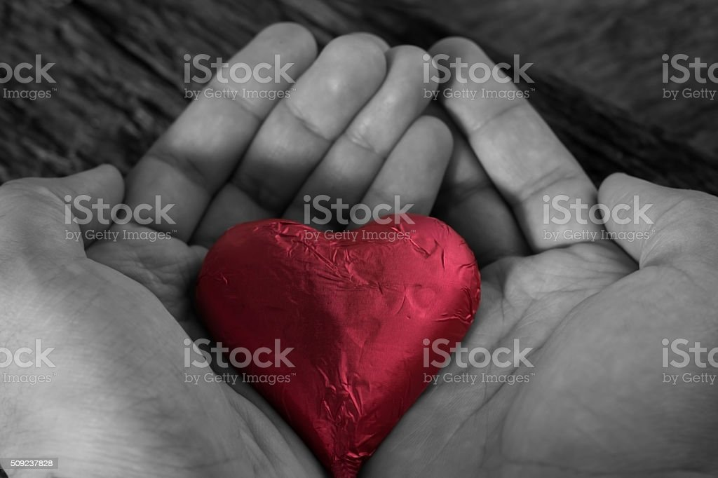 valentines day concept. holding a red heart in hands. stock photo