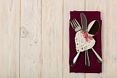 Valentine's day concept. On the wooden table cutlery