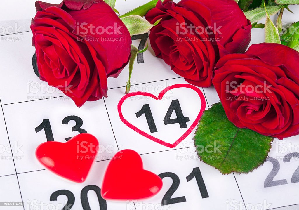 Valentines day concept with calendar and red roses stock photo