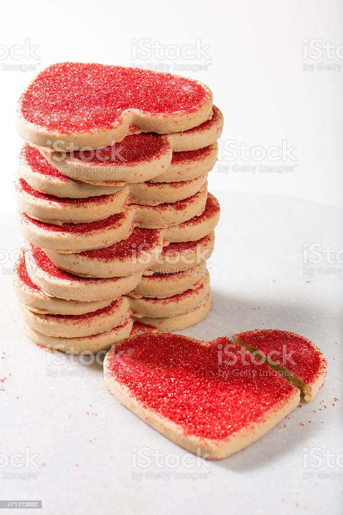 Valentine's Day cookies, with broken heart over marble board stock photo