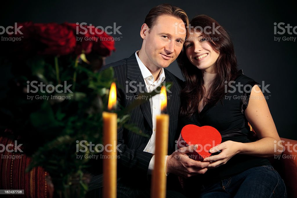 valentine's day couple exchanging gifts royalty-free stock photo