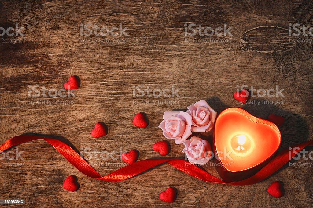 valentine's day, dark background candle heart, scarlet ribbon stock photo