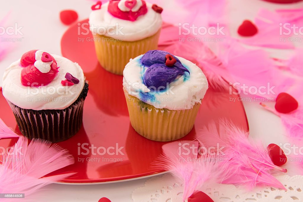 Valentines Day decorations and cupcakes with heart shaped frosti stock photo