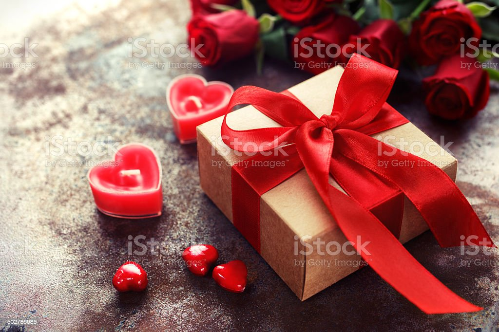 Valentine\'s Day, Gift box of kraft paper with a red ribbon and...
