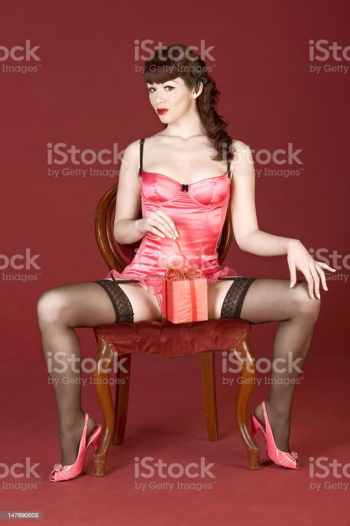 Valentine's day gift open by pin up sexy woman stock photo