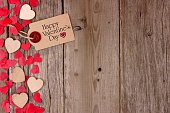 Valentines Day gift tag and heart side border on wood
