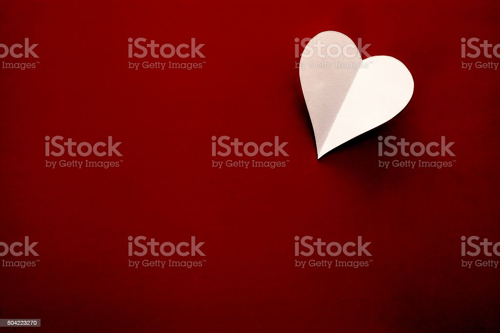 Valentines day heart on red background stock photo