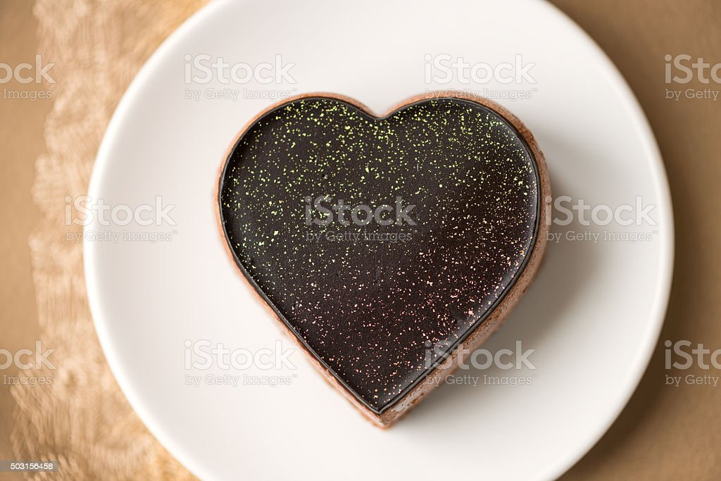 Valentine's Day Heart Shaped Chocolate Mousse Cake with Gold Dust stock photo