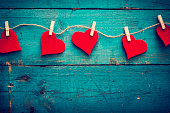 Valentines day hearts on wooden background
