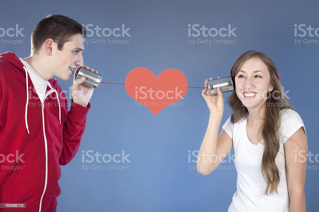 Valentine's Day Man and Woman Communicating on Tin Can Phone royalty-free stock photo