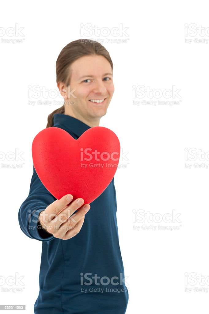 Valentines day man reaching a red heart stock photo