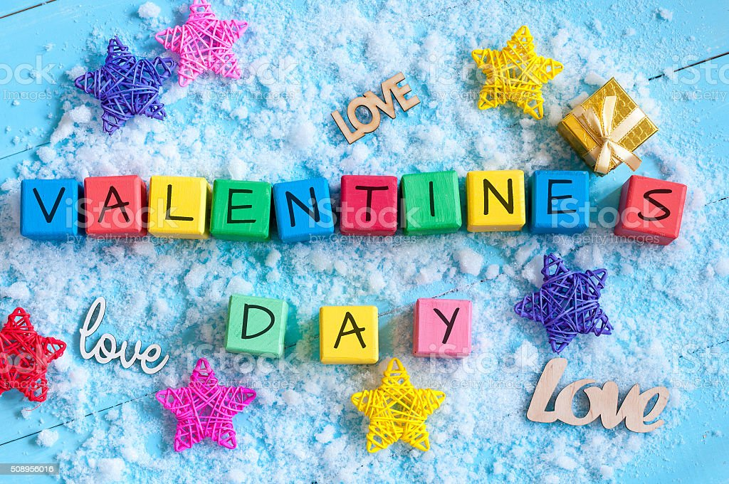 Valentines Day on colour wooden cubes On light blue background stock photo