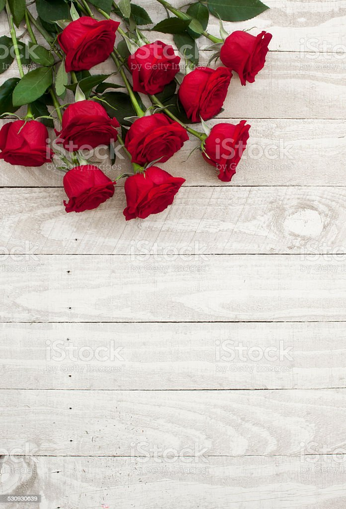 Valentine's day red roses bouquet on old rustic wood table stock photo