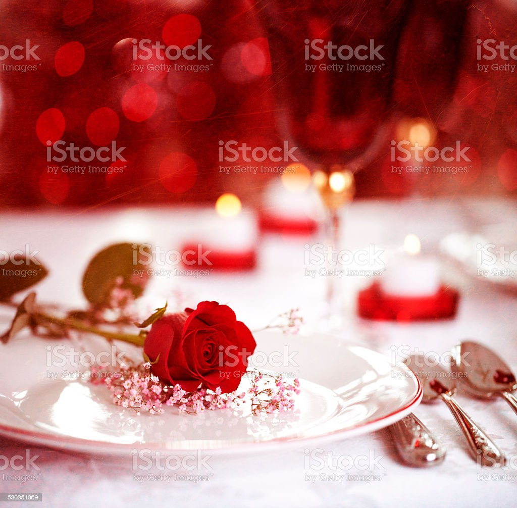 Valentines day red roses, grunge textured background with candles stock photo