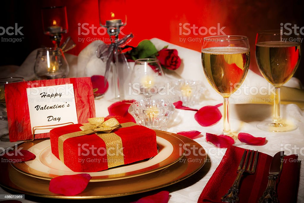 Valentine's Day: Romantic table place setting. Dining, candlelight dinner. Gift. royalty-free stock photo