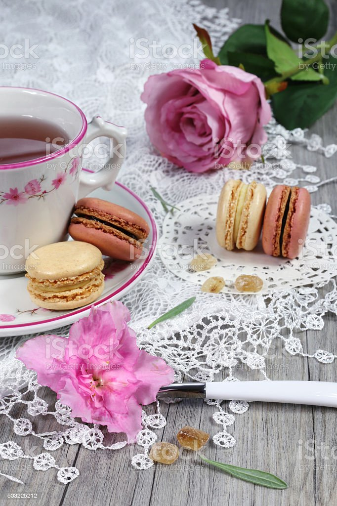 Valentine's Day: Romantic tea drinking with macaroon and hearts stock photo