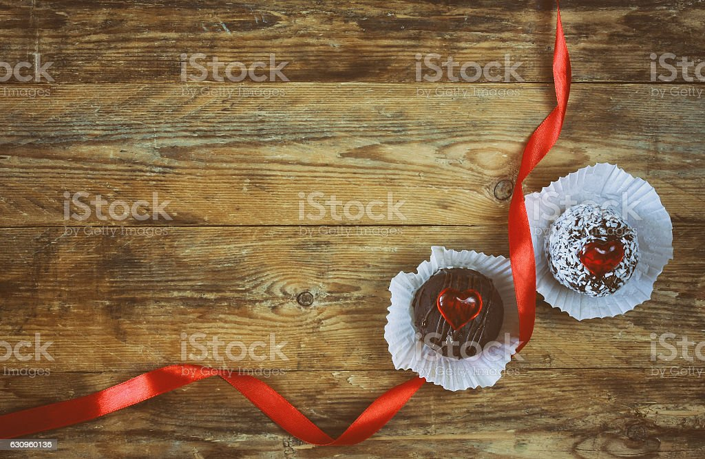 valentine's day, sweet pastries, hearts, scarlet silk ribbon stock photo