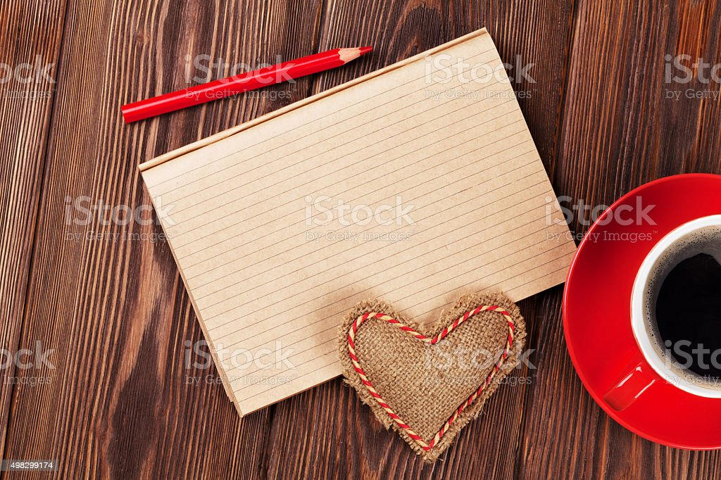 Valentines day toy heart, coffee cup and notepad stock photo