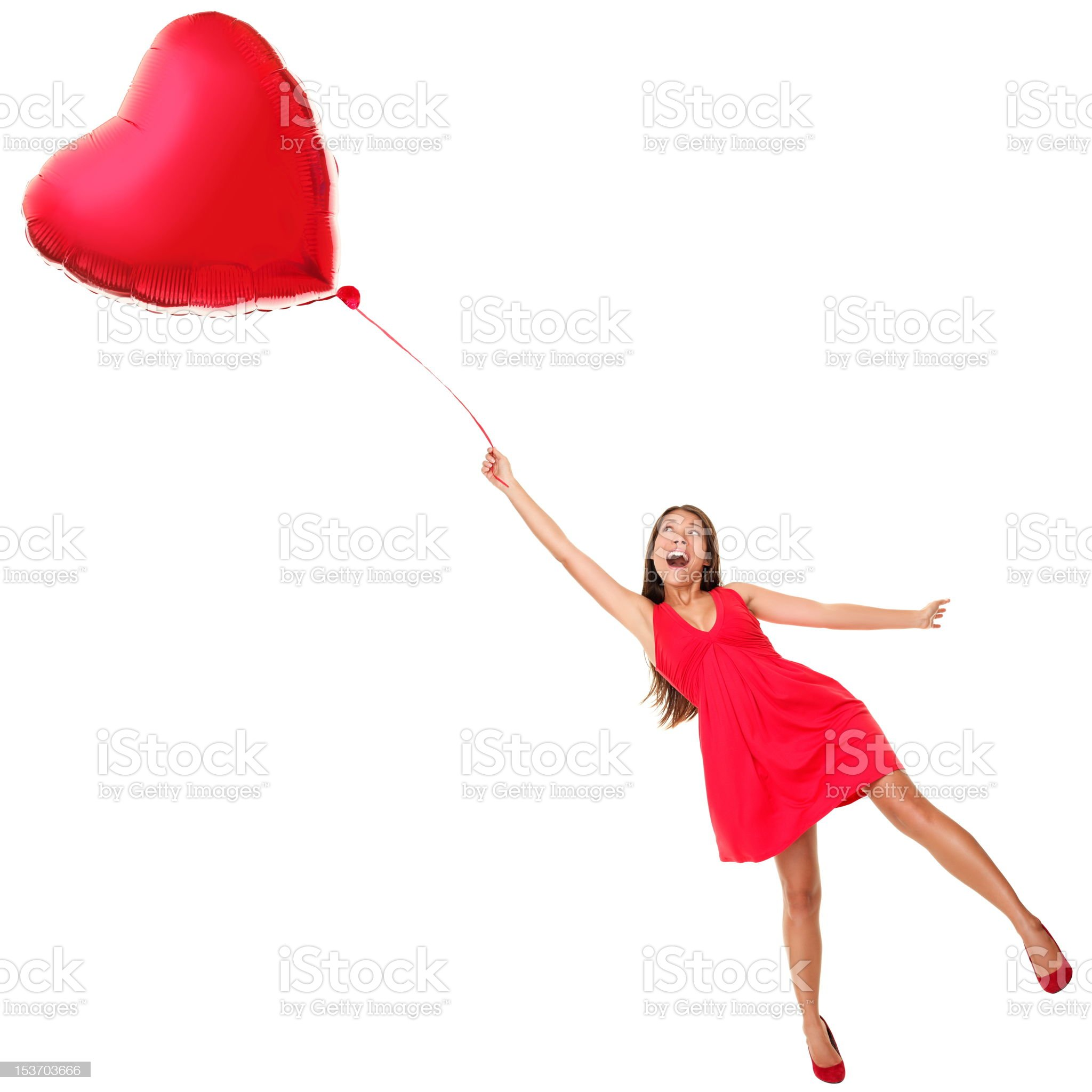 Valentines day woman flying with heart balloon royalty-free stock photo