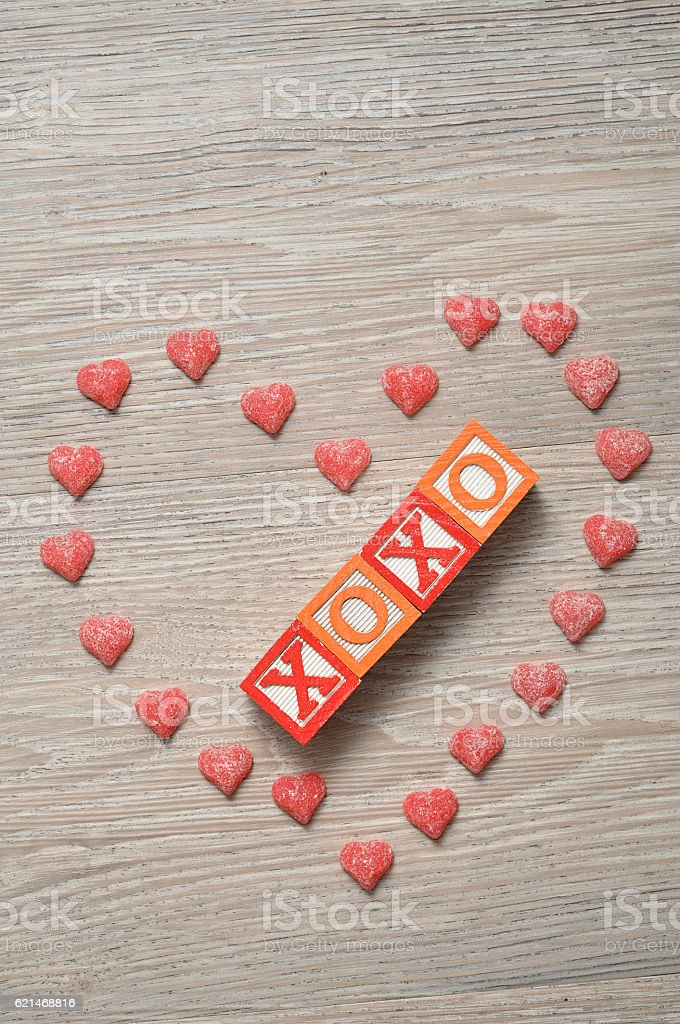 Valentine's Day. XOXO Spelled with colorful alphabet blocks stock photo