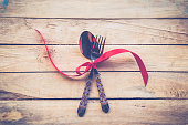 Valentines dinner on wooden background with space. Vintage style