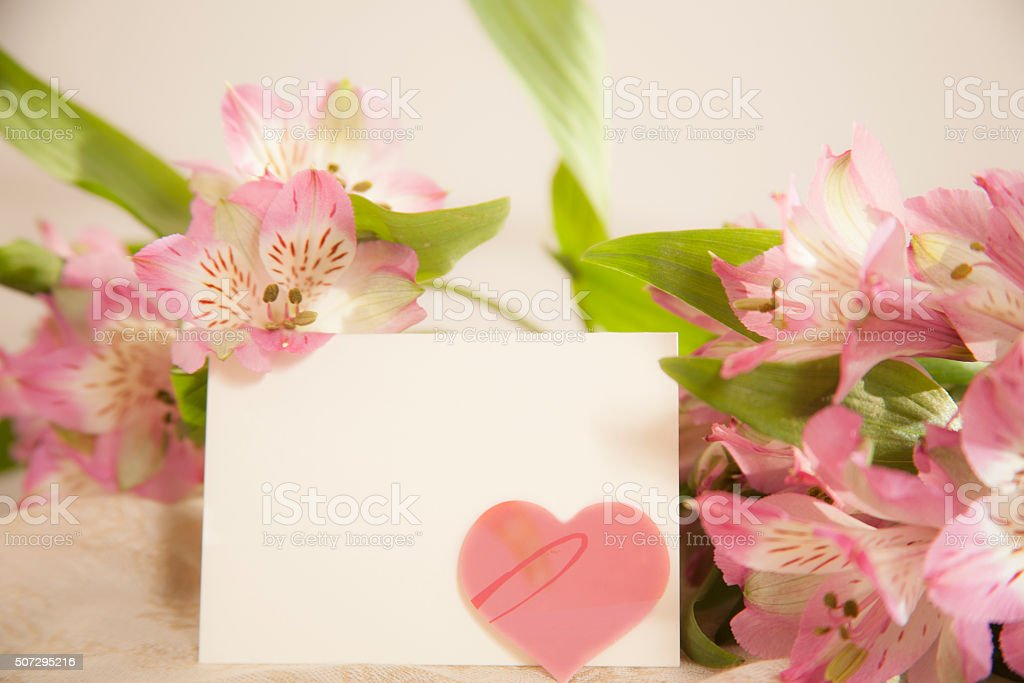 Valentine's, Easter, Mother's Day. Flower bouquet with blank notecard. Heart. stock photo