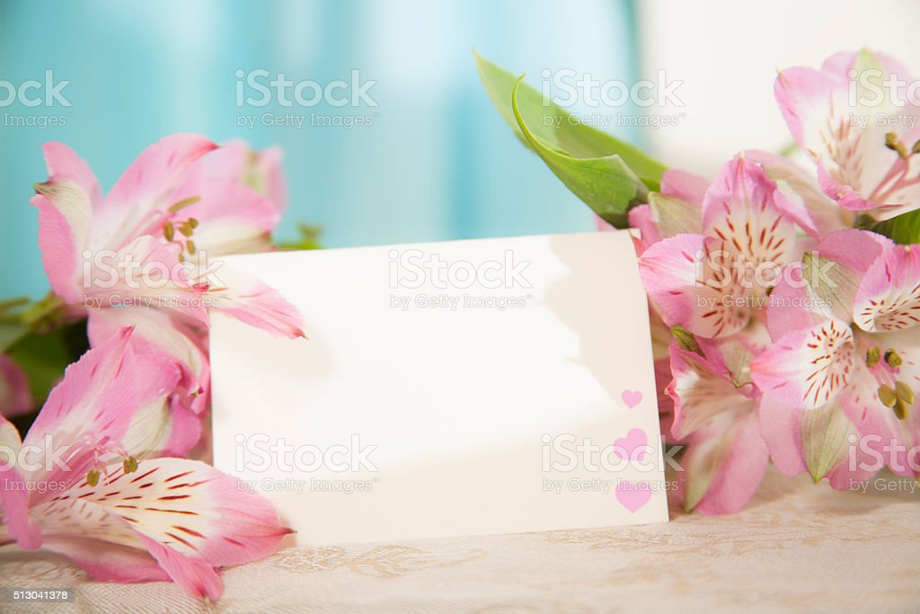 Valentine's, Easter, Mother's Day. Flower bouquet with blank notecard. Hearts. stock photo