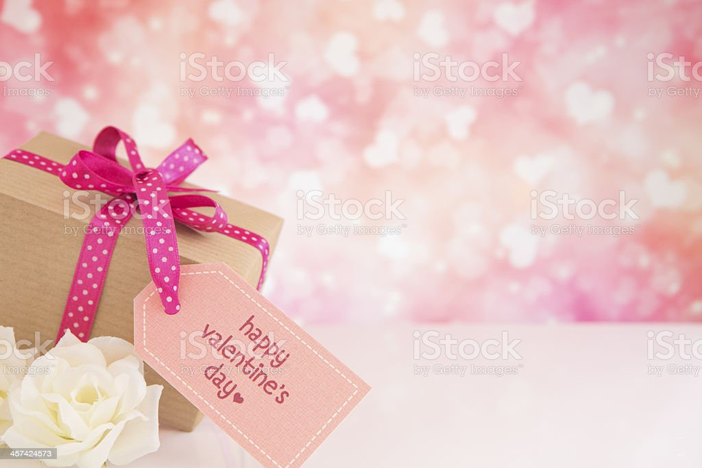 Valentine's gift and roses with a bright glittering background royalty-free stock photo