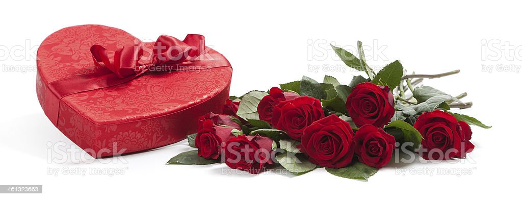 Valentine's gifts including a bouquet of roses and candy heart stock photo