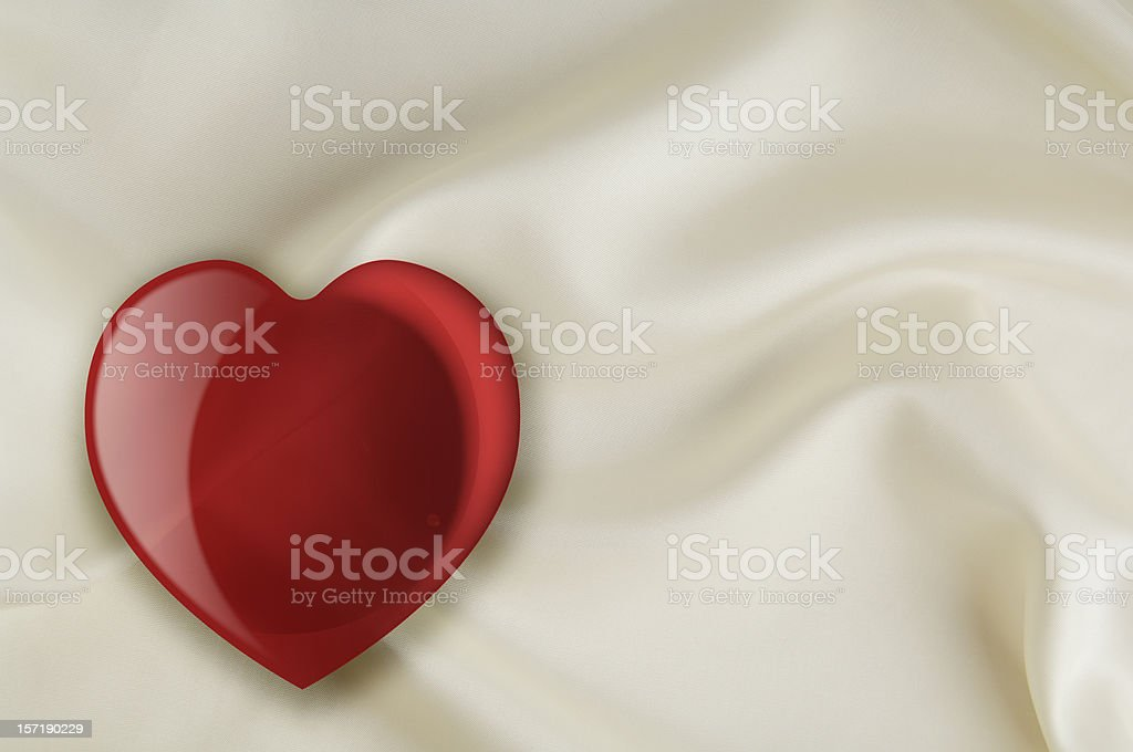 Valentines heart on white satin background royalty-free stock photo