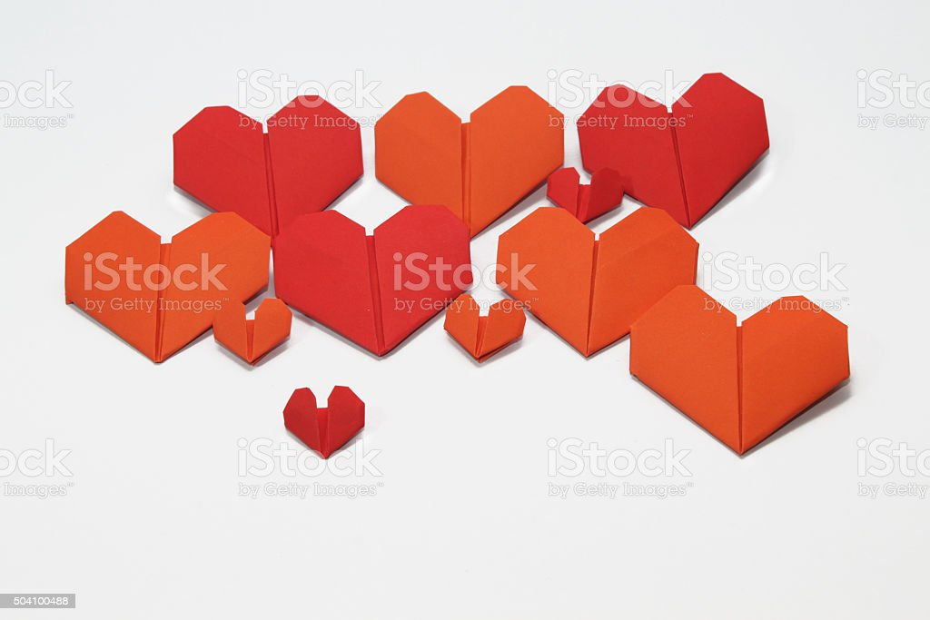 Valentine's heart shaped folded papers, isolated on white background stock photo