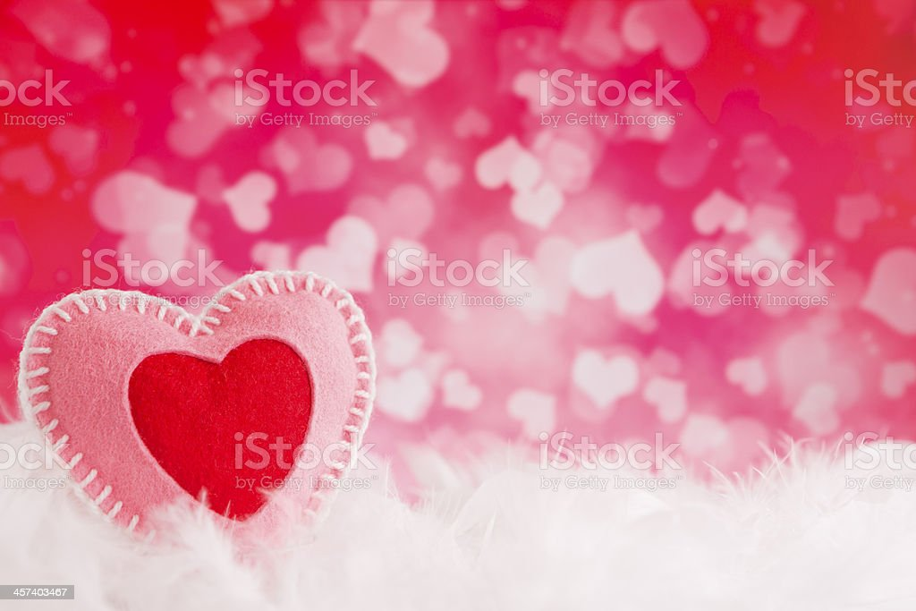 Valentine's hearts on a soft feathery background royalty-free stock photo