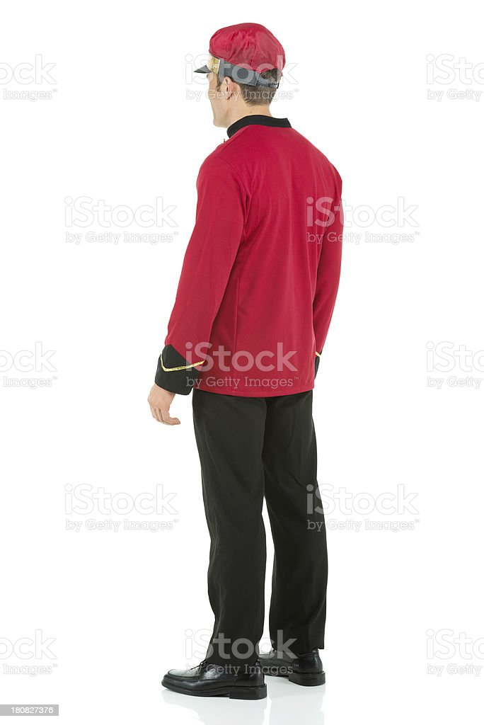 Valet standing against white background royalty-free stock photo