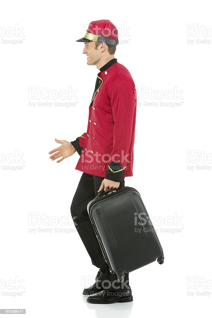 Valet walking with luggage royalty-free stock photo