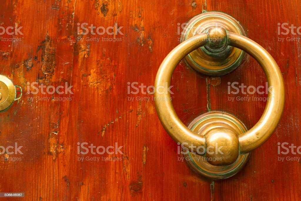 Valetta, Malta: Bronze Door Knocker on Old Reddish Door stock photo