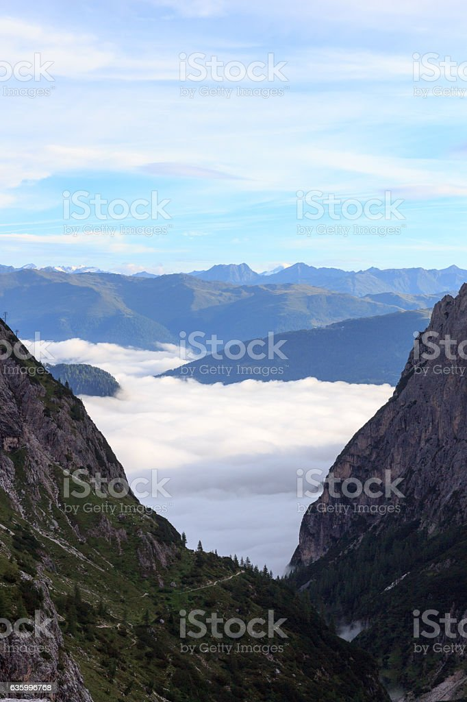 Valley Fischleintal, clouds and mountains in Sexten Dolomites, South Tyrol stock photo