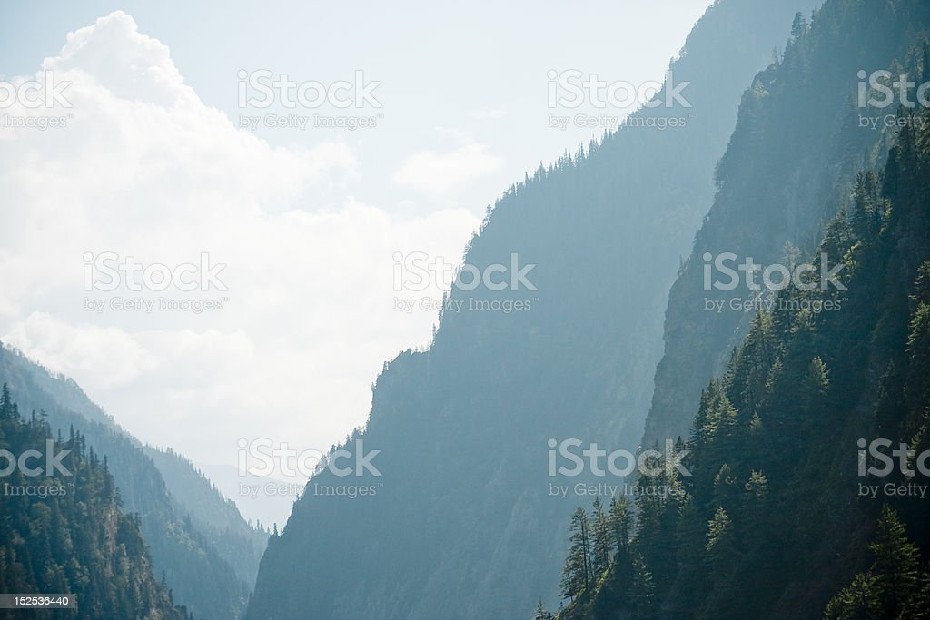 valley in Himalayas with silhouette of mountain royalty-free stock photo