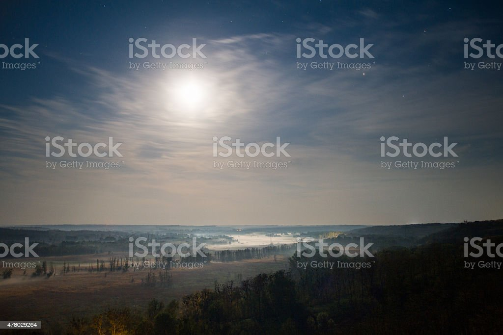 Valley in moonlight stock photo