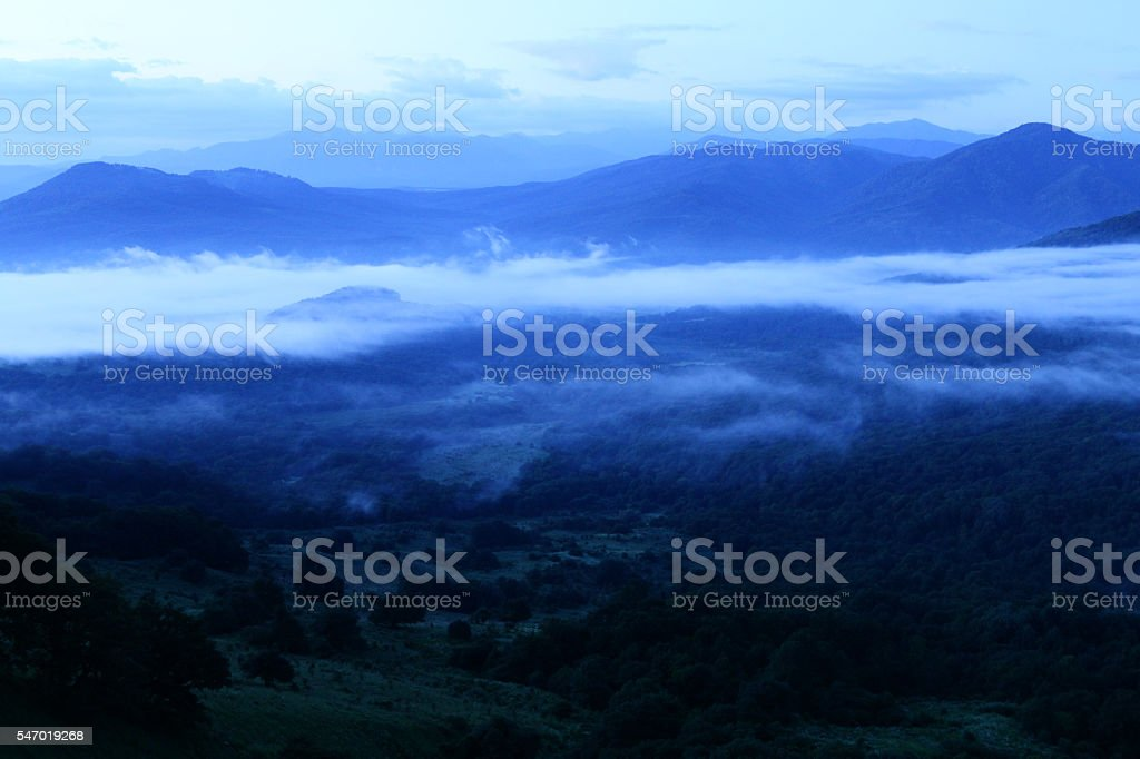Valley in the fog. stock photo
