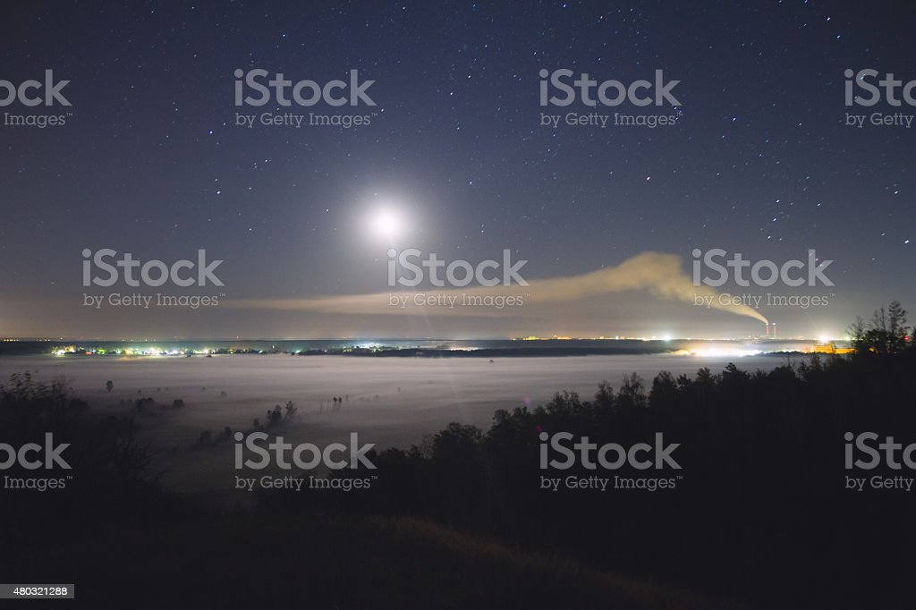 Valley in the mist and moonlight stock photo