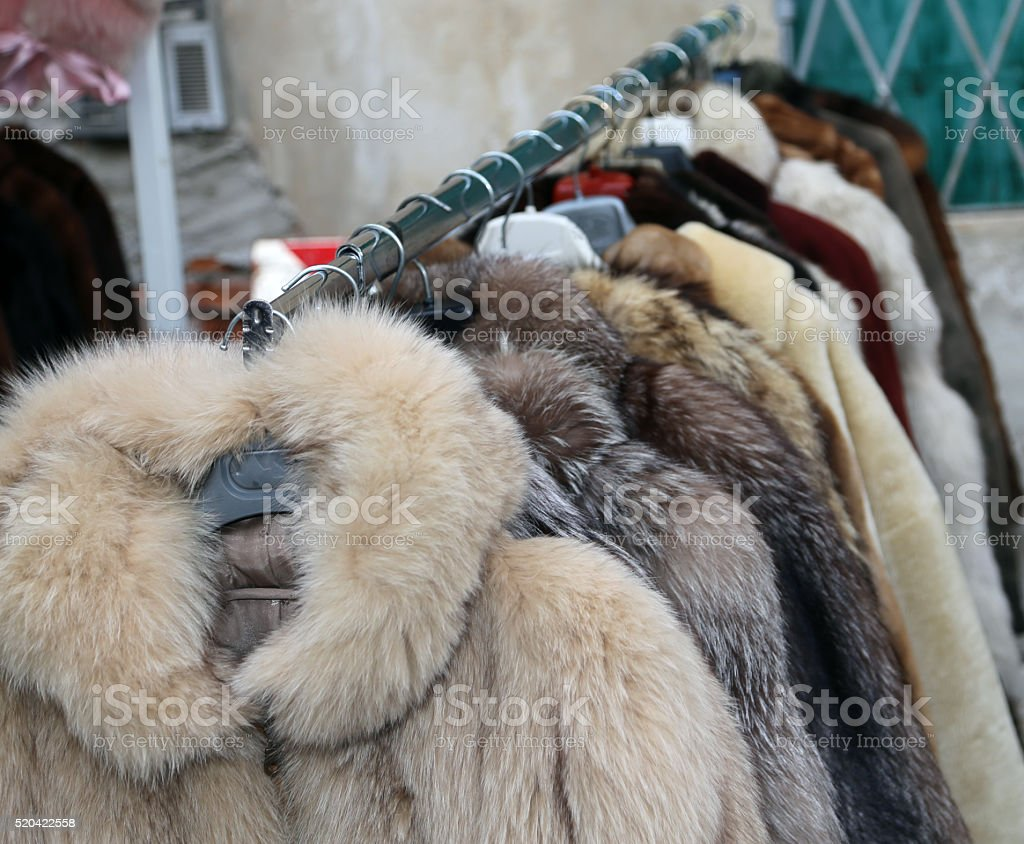 valuable fur coat in vintage style for sale stock photo