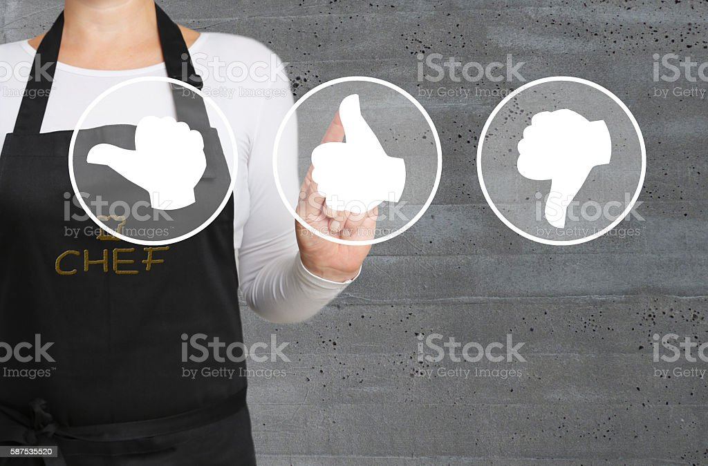 valuation thumbs touchscreen is operated by chef stock photo
