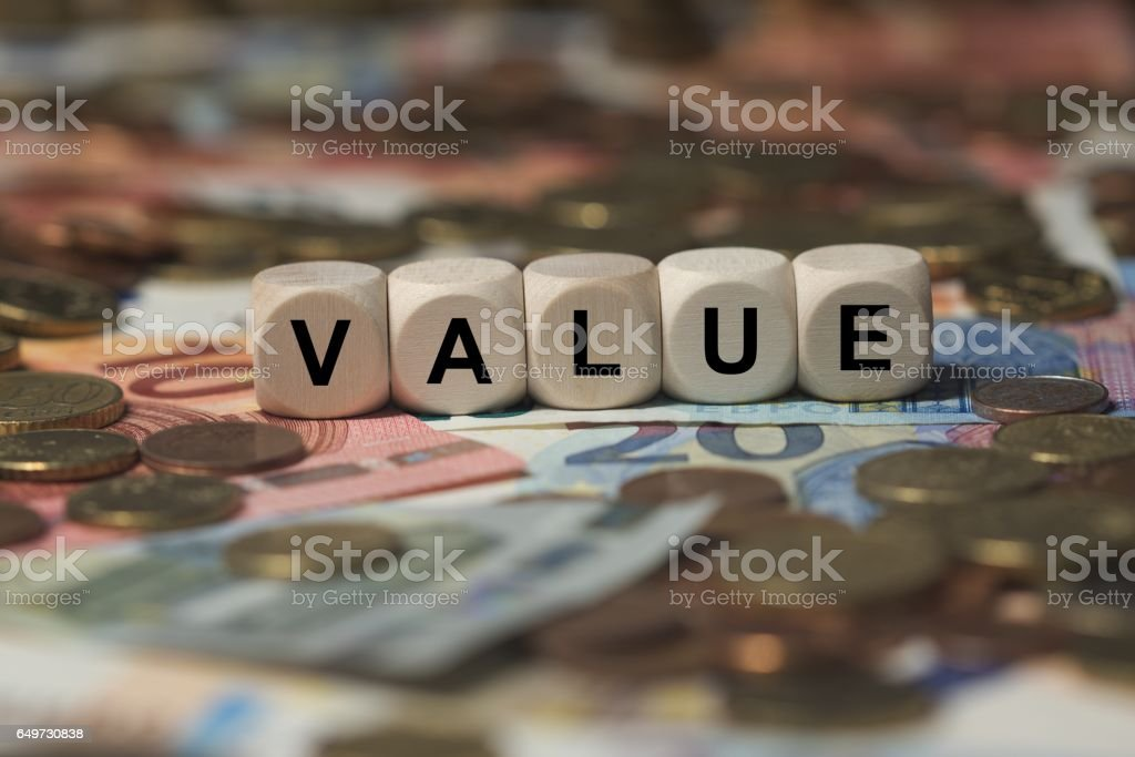 value - cube with letters, money sector terms - sign with wooden cubes stock photo