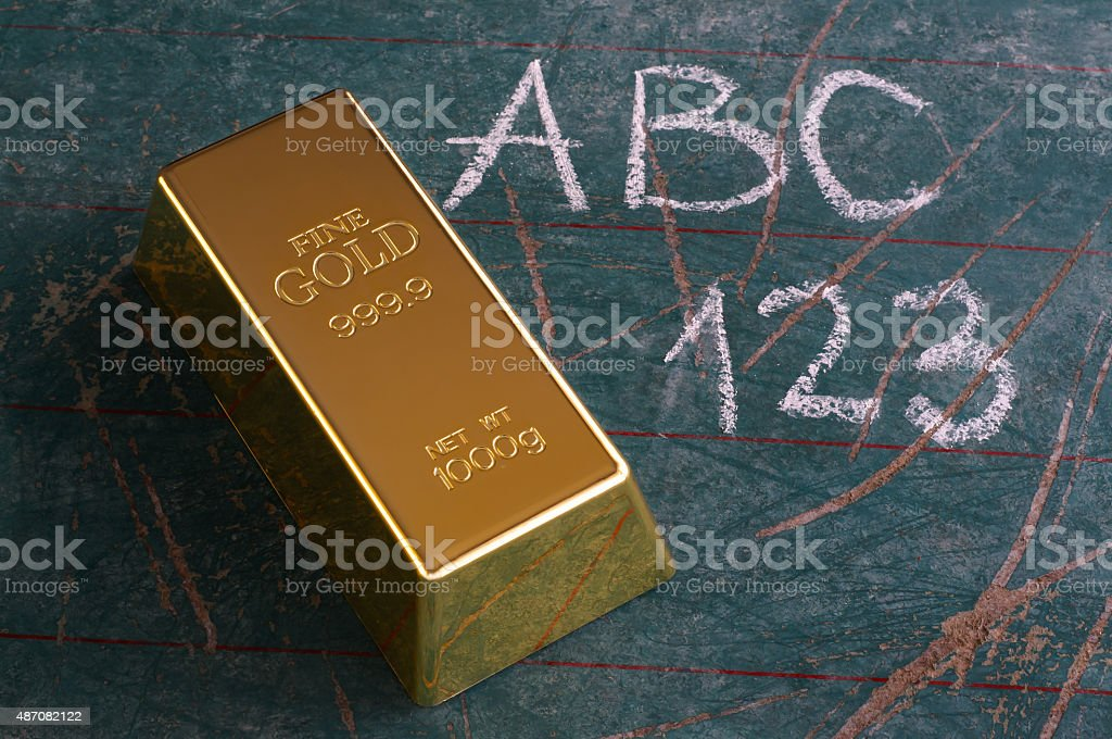 Value of Education Concept Gold Ingot on Old Schoolboard stock photo