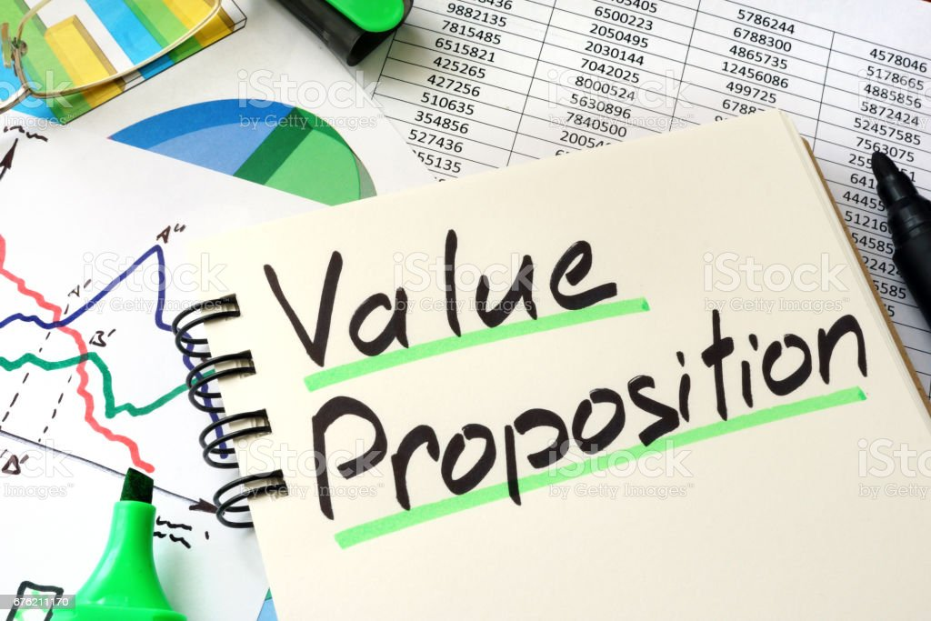 Value Proposition written on a notepad sheet. stock photo