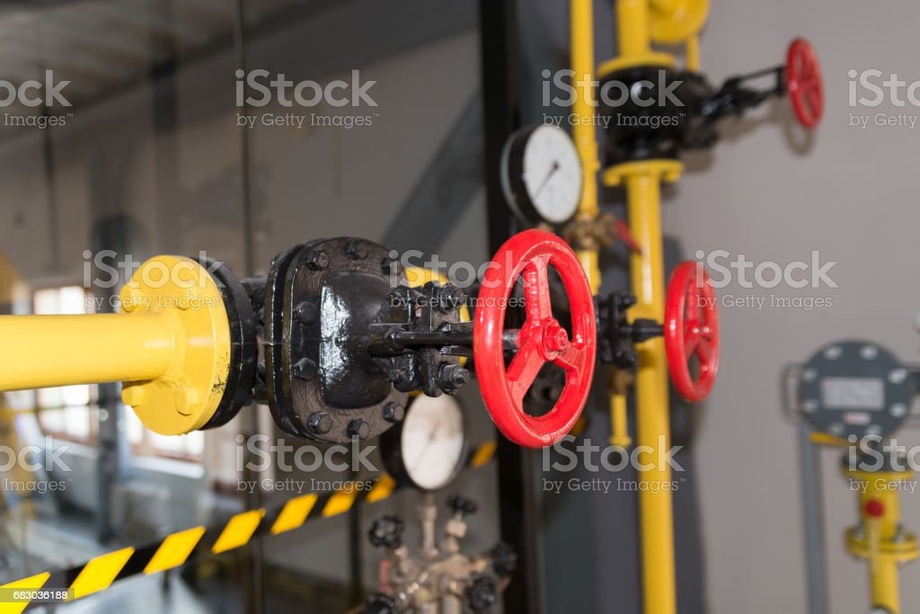 valve on the pipeline in the old power plant stock photo