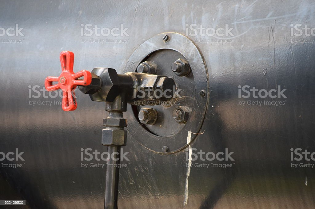 Valve on the steam boiler stock photo